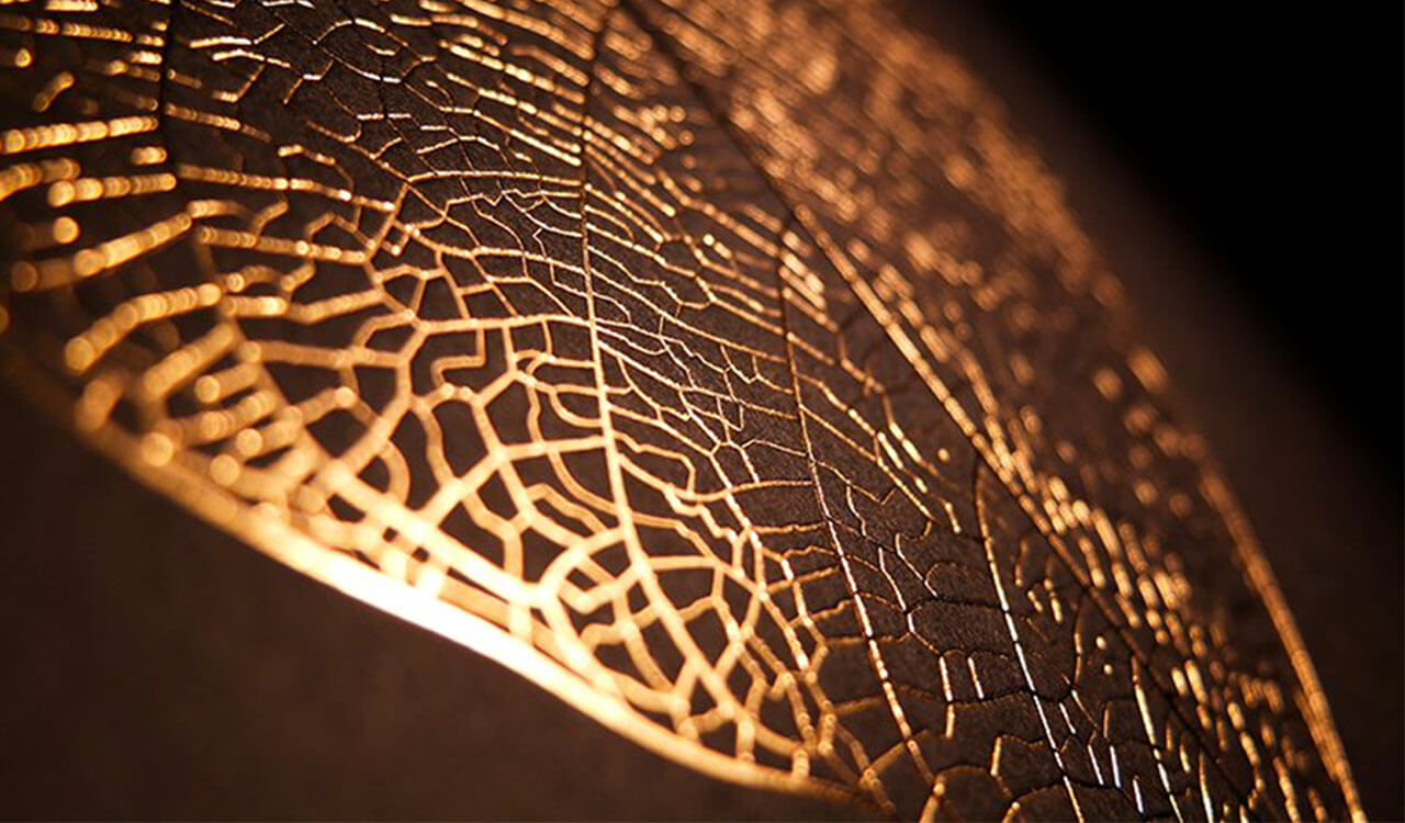 Hot foil stamping in gold with finest structures of a leaf